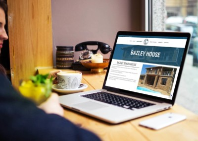 macbook-bazley-beach-accommodation-website-design-south-africa-web-branding-agency-